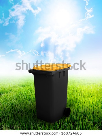 Black And Yellow Recycle Bin Ecology Concept With Landscape Background.