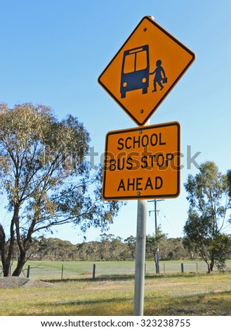 black and yellow school bus stop ahead sign - stock photo