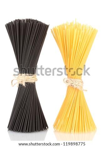 Black and yellow spaghetti isolated on white - stock photo