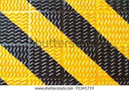 black and yellow strip on steel walkway - stock photo