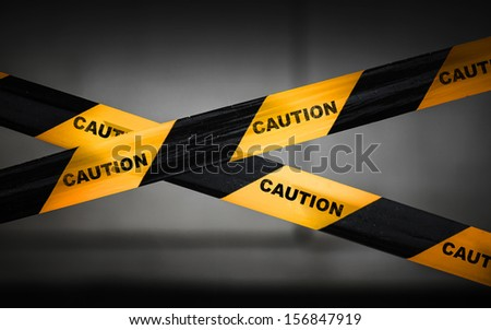 Black and yellow striped caution tape barrier - stock photo