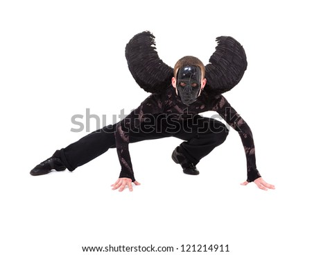 black angel with wings posing, isolated over white background with copy space. - stock photo