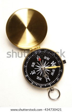 Black antique compass on white background - stock photo