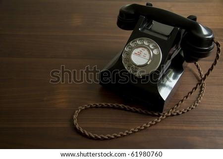 Black antique telephone - stock photo