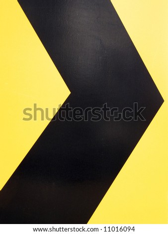 Black arrow on yellow indicating go right - stock photo