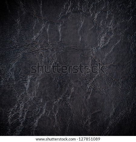 Black artificial leather background - stock photo