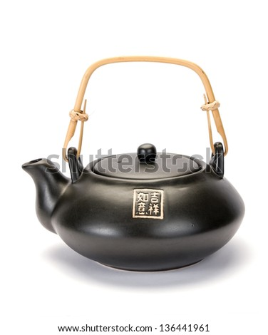 black asian teapot in white background - stock photo