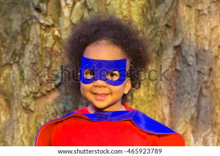 Black baby in super hero costume. The winner and success concept.