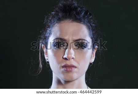 black background of annoyed woman