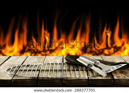 black background of fire and free space on table  - stock photo