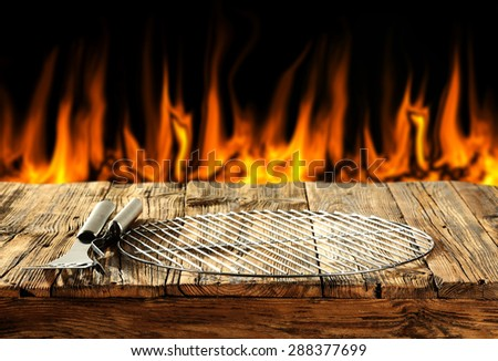 black background of fire and grilling time  - stock photo