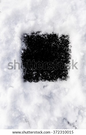 Black background round shape in the snow. Perfect window frame for any picture, just replace black color with your image in photo editor, by layered over it in screen mode. - stock photo