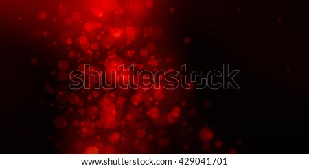 black background with red blurred Christmas lights - stock photo