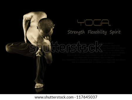 Black background with young man shows difficult yoga exercise