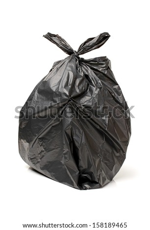 Black bag of rubbish on white background  - stock photo