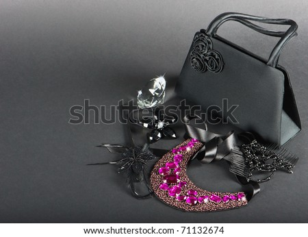black bag with woman accessories - stock photo