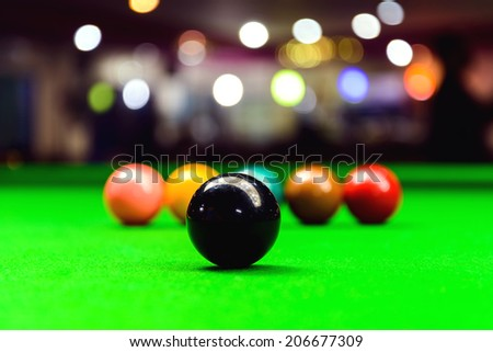 Black ball on snooker table