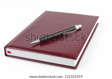 Black ballpoint pen on the leather cover diary - stock photo