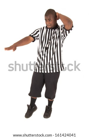 black basketball referee calling a charging foul - stock photo