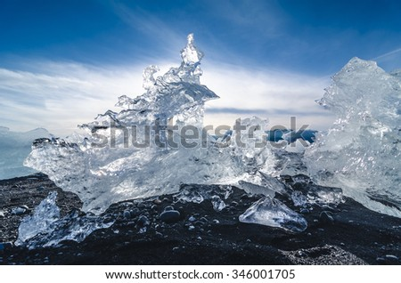 black beach with pieces of ice, Iceland - stock photo