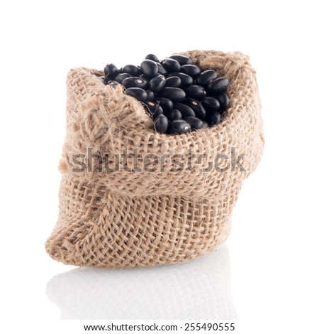 Black beans bag isolated on white background.
