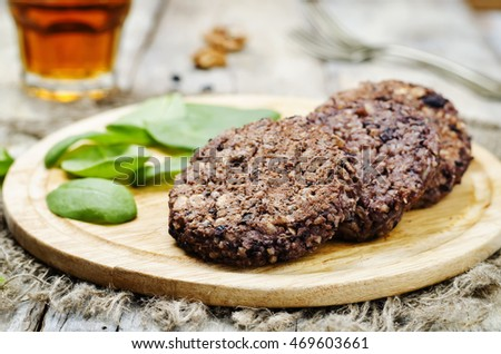 black beans brown rice walnut oat burgers with spinach. toning. selective focus