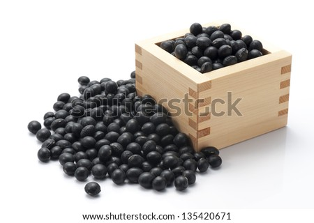 black beans on white background - stock photo