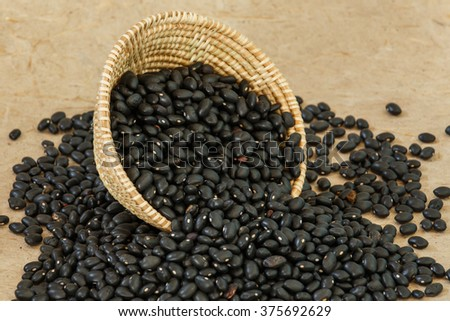 Black beans, seeds, nuts, grains, plants.