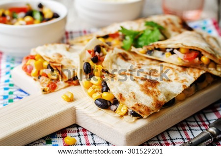 black beans tomato corn quesadilla. the toning. selective focus