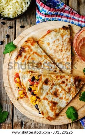 black beans tomato corn quesadilla. the toning. selective focus - stock photo