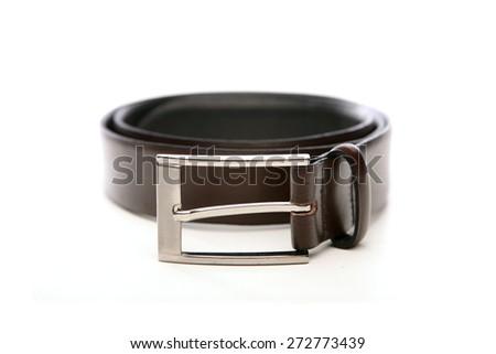 Black belt on white bacground - stock photo