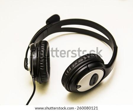 Black big headphones on a white background - stock photo