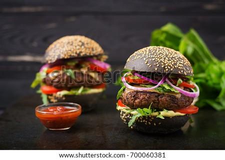 Three Hamburgers On Colorful Bred Buns Stock Photo - Black hamburger