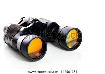 Black binoculars with orange lens isolated on white background - stock photo