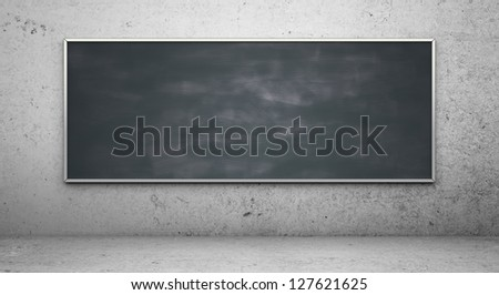 Black blackboard in concrete room - stock photo