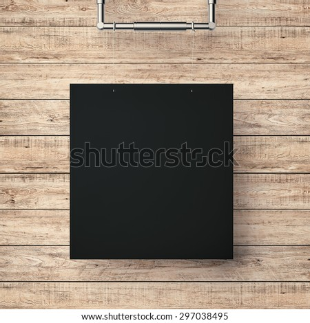 black blank frame hanging on timber wall