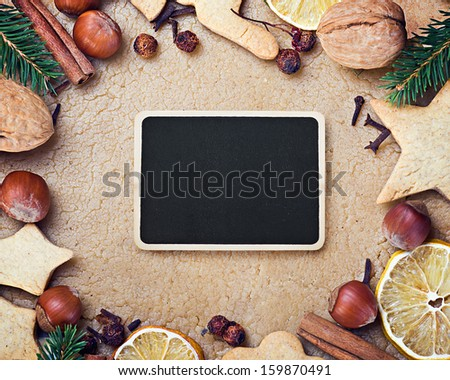black board for greetings and facilities for making Christmas cookies - stock photo