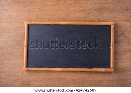 black board on wooden background