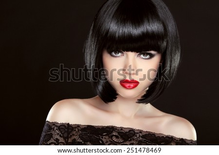 Black bob hair. Fashion model girl face. Brunette woman with red lips and short hairstyle over dark background. - stock photo