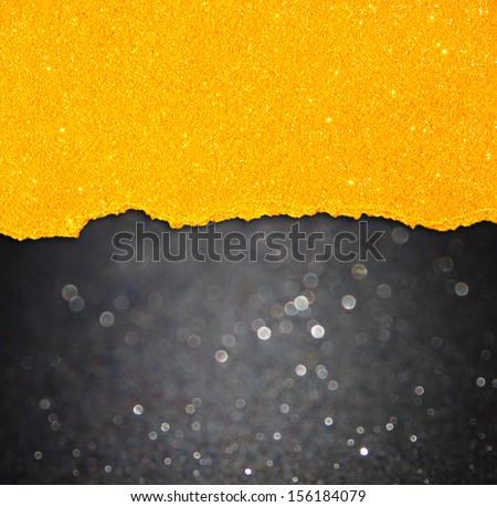 black bokeh lights and orange torn paper - stock photo