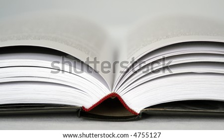 Black book extremly close on a white background