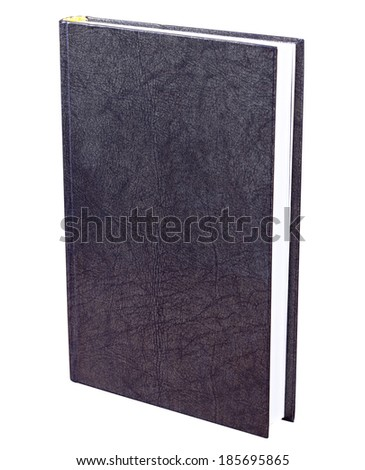 Black book with patterned hardcover standing isolated on white background