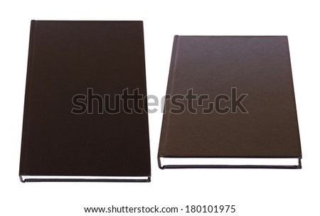 Black books with blank hardcover lying isolated on white background