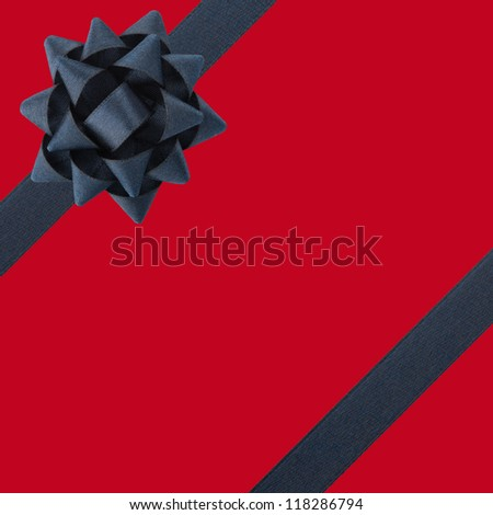 Black bow and ribbons over red background