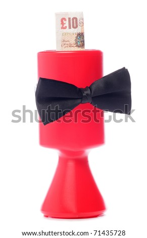 Black bow tie charity donation with ten pounds studio cutout - stock photo