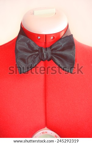 Black bow-tie on the red dummy - stock photo