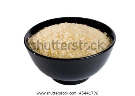 Black bowl full of rice (isolated on white) - stock photo