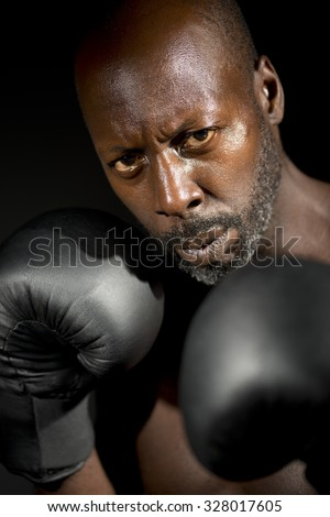 Black Boxer Against Black Background - stock photo