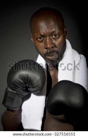 Black Boxer With White Towel  - stock photo