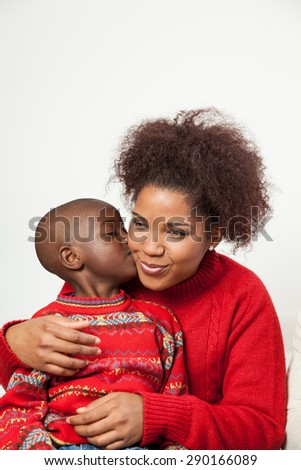 Black boy kissing his mother - stock photo